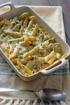 Pesto Penne and Cheese - Mac and cheese is one of life's ultimate comfort foods. Cozy up with a plate of this rich and cheesy, Pesto Penne and Cheese to while away whatever worries you may have.