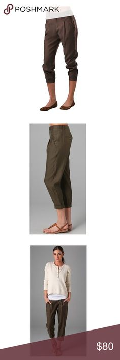 """Cropped Slouch Pants These slouchy, pleated crop pants feature slant hip pockets and button-welt back pockets. Basque yoke at waist and cuffs at hem. Single hook-and-eye closure.         62% rayon , 38% cotton      16"""" in the knee narrows to 12"""" at the leg opening      Front slash pockets      Dry clean only      Manufacturer Style No. V0430 20535  * 10"""" rise. 23"""" inseam.  * Fabrication: Sateen twill. Vince Pants Ankle & Cropped"""