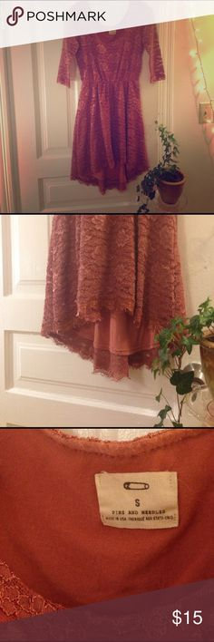 Romantic vintage-inspired lace dress This lovely salmon pink lace dress is inspired by vintage romanticism with a modern twist. The dress has a cinched waist and a high-low hem. Sold at Urban Outfitters, made in the US. Pins & Needles Dresses High Low