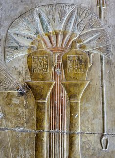 "EGYPT | Nemset vessels in Horus Shrine at Abydos | This relief detail on the west wall of the Horus Shrine in the Seti I Temple at Abydos shows a bouquet of lotus flowers and two ""nemset vessels"". This kind of spouted vase was used to sprinkle water in purification rites. The relief is part of a scene in which Seti is offering incense to Horus. The Horus Shrine is one of three small shrines that are located north of the Inner Osiris Hall. The Seti Tem..."
