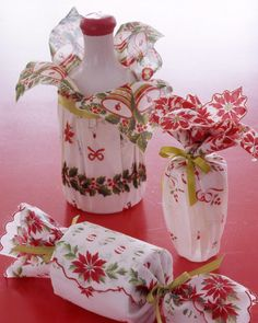Wrap goods in vintage napkins, handkerchiefs, or other linens graced with lively patterns, and the packaging itself will serve as an added gift. Look for linens at flea markets or online. Fabrics are particularly helpful when wrapping articles whose shapes don't lend themselves to paper. The rest is a cinch: Gather fabric around item; tie with ribbon.