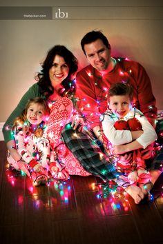 Family Christmas pic - Pj's and Christmas lights <3