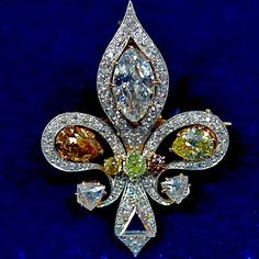 Antiques Jewelry Fleur-de-lis brooch made (allegedly) with colored diamonds smuggled out of France during the revolution. circa 1900 Do you love this Old Jewelry, I Love Jewelry, Antique Jewelry, Vintage Jewelry, Fine Jewelry, Jewelry Design, Jewelry Making, Jewellery, Diamond Brooch