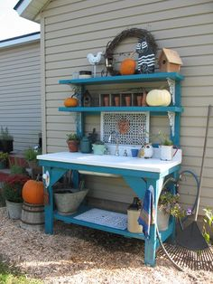My garden bench with sink dressed up for Fall.