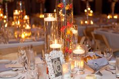 Rent multiple cylinder vases and use floating candles and sumberged branches for wedding centerpiece - photos by Becky Brown Photography | junebugweddings.com