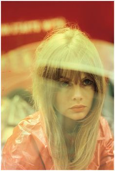 AUGUST 1966. Jean Shrimpton Photographed by Saul Leiter for a British Vogue beauty story on red make-up