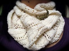 This cowl combines two of my favorite elements: openwork/lacy patterning and a cotton blend yarn. Rowan Wool Cotton is great for showing off stitch definition without being scratchy. The stitch pattern is comprised of a shield surrounded with openwork, providing an interesting lacy design with a feminine touch.