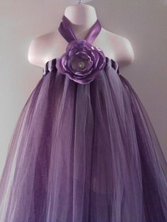 "hmm...use the ""how to make a tutu"" but add a flower and neck part...i think so!"