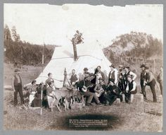 Title: Happy Hours in Camp. G. and B.&M. Engineers Corps and Visitors Small group of men and women and two deer in front of a tent. Some of the men are playing musical instruments. 1889. Repository: Library of Congress Prints and Photographs Division Washington, D.C. 20540 #.