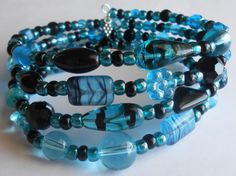 Chilly Aqua Blue and Black Mixed Silver Oval Memory Wire Bracelet by VineDesignBeads. Visit me on Etsy!