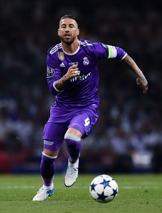 Sergio Ramos of Real Madrid CF runs with the ball during the UEFA Champions League Final between Juventus and Real Madrid at National Stadium of Wales on June 3, 2017 in Cardiff, Wales.