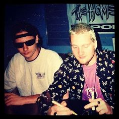 Jerry Cantrell and Layne Staley signing some autographs