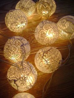 use doilies and modge podge over balloons to make the perfect string lights for the bedroom!  (Use RIT dye for a rust or dark red/wine color!)