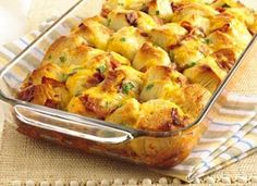 Bacon-Cheese Pull-Aparts Recipe - 8 pc Pillsbury biscuits cut in fourths, 1 egg, milk, bacon and cheddar cheese. Yum