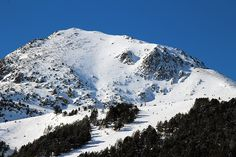 Andorra, in the Pyrenees between France and Spain, is one of Europe's largest ski areas. Make your next winter trip an Andorra ski holiday with our guide.