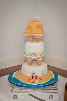 A fun and colourful beach inspired cake  | Photography by http://www.mia-photography.com/