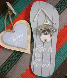 Wall mounted blue wooden flip flop with strong silver metal bottle opener and Life is BETTER at th beach writen in white rope detail to front and Beer Bottle Opener, Bottle Openers, Wood Projects, Woodworking Projects, Beach Signs Wooden, Wall Mounted Bottle Opener, Diy Bottle, Bottle Crafts, Beer Signs