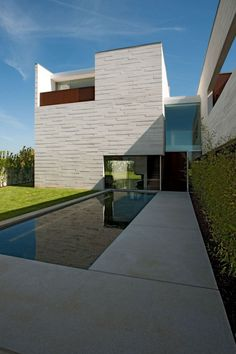 House in Aldoar / Topos Atelier de Arquitectura. plans pinned nearby. click 4 pics.