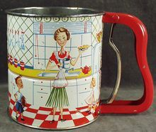 Old Androck Flour Sifter with Kitchen Scene............1950s