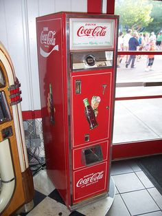vintage coke signs | slender vintage coke machine a thin old coke vending machine inside a ...