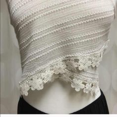 Lacey summer fun top Unique lace crop top. The design of this top is flattering to the girly girl in you. Th angles of the front cover the belly when sitting . So cute with your favorite short , jeans or summer skirt. Add your favorite necklace and your set for the day.  this top will soon be your go to top for summer. The color is oatmeal goes with everything. Solids or floral prints . Tops Crop Tops