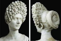 A woman supporting a Flavian style. Would you even wear your hair like this? How long to you think it took to do?