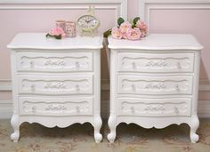 """This elegant pair of nightstands feature three drawers each. The face has lovely rose appliques and glass knobs. Elegant legs taper down into curved feet. A great set for your shabby chic style bedroom.  <BR><BR> • Wood<BR> • White<BR> • Wipe clean with soft cloth<BR> • 24.5""""W x 17.25""""D x 27""""H<BR> • This is a Bella Cottage exclusive one-of-a-kind item <BR><BR><strong>Return Policy</strong><BR> Due to the size of this piece this item is not eligible for ..."""