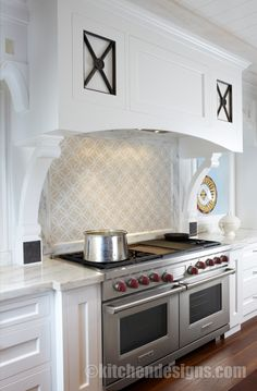 Kitchen Designs by Ken Kelly White Kitchen Design Ideas for an open hearth with Wolf range and custom X forged iron design in wood hood. Ben...