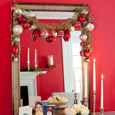 A traditional green garland gets an unexpected holiday update thanks to festive ball ornaments. Simply drape your garland across a mirror or mantel or along a banister in your home and hang ornaments from it, bending the hooks around the vine to secure./