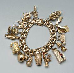 1219: Tiffany gold charm bracelet, : Lot 1219