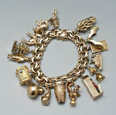 1219: Tiffany gold charm bracelet, : Lot 1219