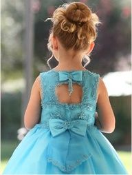 FLOWER GIRL: Hair. An updo with ringlets curling at the front. Also with a small beaded flower in the side c