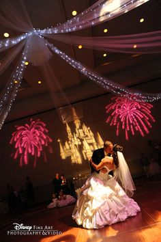 Sealed with a kiss- and a tulle canopy and Cinderella Castle gobo! [ BookingEntertainment.com ] #wedding #events #entertainment