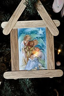 Recycle a Christmas card into a Nativity Ornament or kids cld draw a picture and then glue it behind sticks.