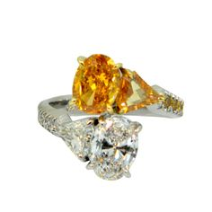 Fancy Vivid Orange-Yellow and D Internally Flawless Oval Diamond Bypass Ring | From a unique collection of vintage cocktail rings at http://www.1stdibs.com/jewelry/rings/cocktail-rings/