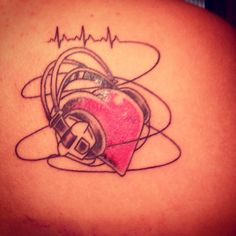Music Tattoo. Heart with headphones and heart beat.