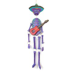 This cool guitarista is a Day of the Dead version of a traditional Mexican mariachi player