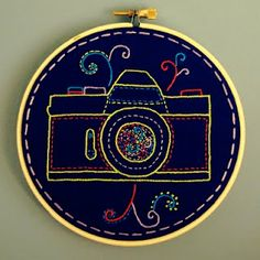 feeling stitchy: Photo Finish-love the bright colors in the dark fabric! Hand Embroidery Stitches, Hand Embroidery Designs, Embroidery Art, Applique Designs, Cross Stitch Embroidery, Cross Stitch Patterns, Diy Gifts For Men, Easy Diy Gifts, Modern Cross Stitch