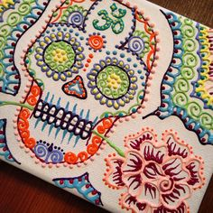 Sugar skull done in acrylic paint on canvas by Henna on Hidsom