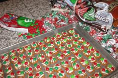 "This uses a ""pretzel snap"", "" Hershey hugs"" & M's, melted in oven (*200 about 7 minutes, till just melted), remove & add holiday M's!"