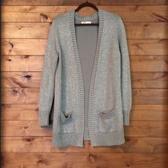 """Long Oversized Cardigan Old Navy long chunky oversized cardigan. It is soft and comfy with a relaxed easy fit. Grey with silver threads woven in. Hits below thigh. Shoulder to hem 34"""". I worn it a couple times. It's in perfect condition. Old Navy Sweaters Cardigans"""
