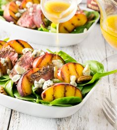 This grilled steak and peach salad is a showstopper! A homemade red wine vinaigrette is drizzled over succulent grilled peaches and tender, thinly sliced, steak mingling in a salad of baby spinach, pecans and blue cheese crumbles. High Protein Salads, High Protein Dinner, High Protein Recipes, Protein Snacks, Protein Dinners, Grilled Steak Recipes, Grilled Meat, Meat Recipes, Salad Recipes