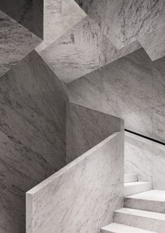 White Carrara marble staircase. David Chipperfield Architects – Valentino Rome Flagship Store.