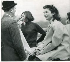 Jackie listening to Dave Powers, a close friend of JFK who worked in the White House. Jackie smoking