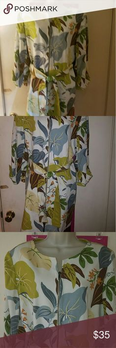 NWT Kelly and Diane Trench Floral Coat Cute Kelly & Diane trench jacket. White with green green blue brown and beige hosta leaves. Zips all the way up. Three quarter sleeves with a button tab. Fully lined. Ties around the waist. One of the little belt loops is torn. Shell is 100% cotton with polyester lining. New with tags. Size 16. Check out the rest of my closet! Kelly & Diane Jackets & Coats Trench Coats