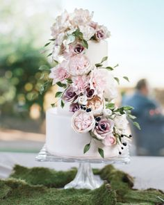 33 Romantic Wedding Cakes | Martha Stewart Weddings - This three-layered Tahitian vanilla pound cake from Anna Parzych Cakes was adorned with blush sugar flowers, berries, and vines cascading down the side of the confection.