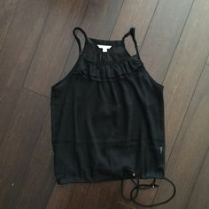 Sheer black tank from AE. Sheer racerback tank from AE with drawstring waist. I loved this when I bought it and then only wore it once. Looks great with white skinny jeans. American Eagle Outfitters Tops Tank Tops