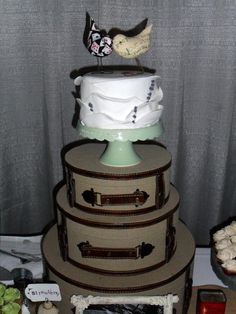 My vegan wedding cake! We had a small cake just so we had something to cut.Bird toppers and cake stand from Etsy and loved the suitcases from Save-On Crafts! We also had mini cupcakes, and the groom's favorite, mini buttermilk pies instead of a second cake. #SpiralDiner #CrossTimbersWInery