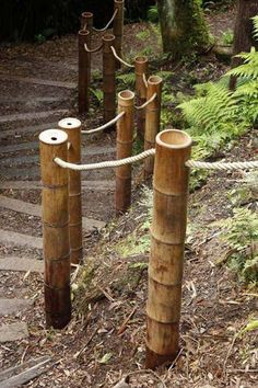 #18. Bamboo side rainlings with rope can be an awesome garden or yard landscape.