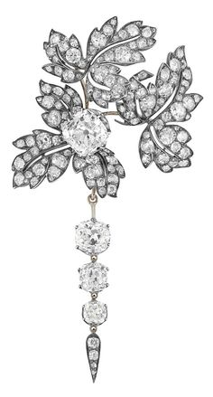 An antique silver, gold and diamond currant 'en pampille' brooch, circa 1850…
